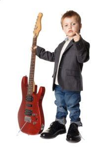 Toddler holding a guitar